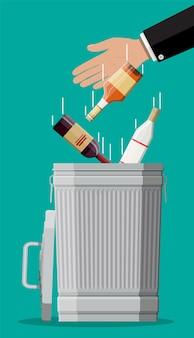 アルコール乱用の概念。酒とゴミ箱のさまざまなボトル