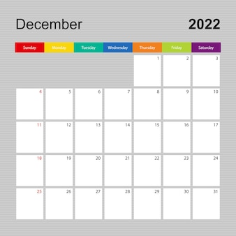 2022年12月のカレンダーページ、カラフルなデザインのウォールプランナー。週は日曜日に始まります。