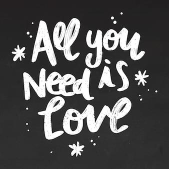 All you need is love lettering on blackboard