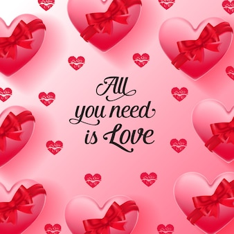 All you need is love lettering and hearts decorated with ribbons