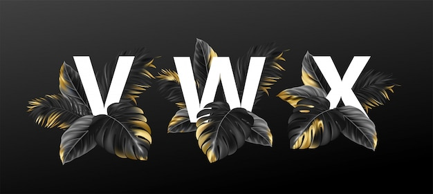 Alphabet letters in  with  exotic tropical leaves of plants.