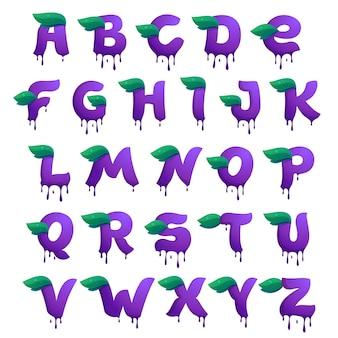 ブルーベリージュースのドロップと葉のアルファベット。