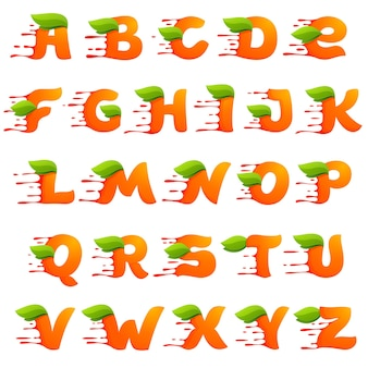 Alphabet with orange juice drops and leaves.