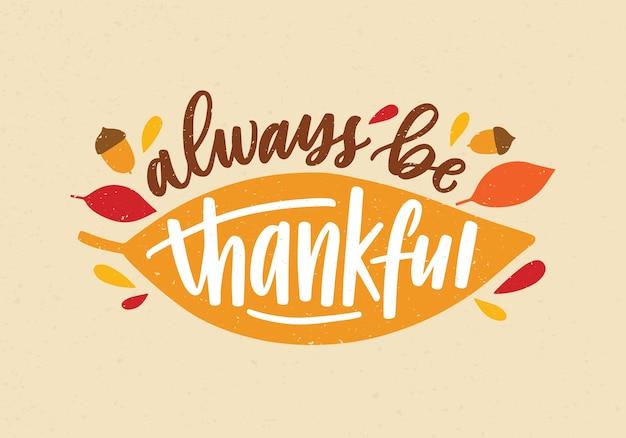 エレガントな筆記体の書道フォントで手書きされた常に感謝の休日の碑文