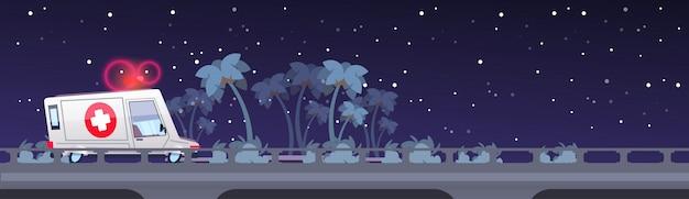 夜の道路上の救急車