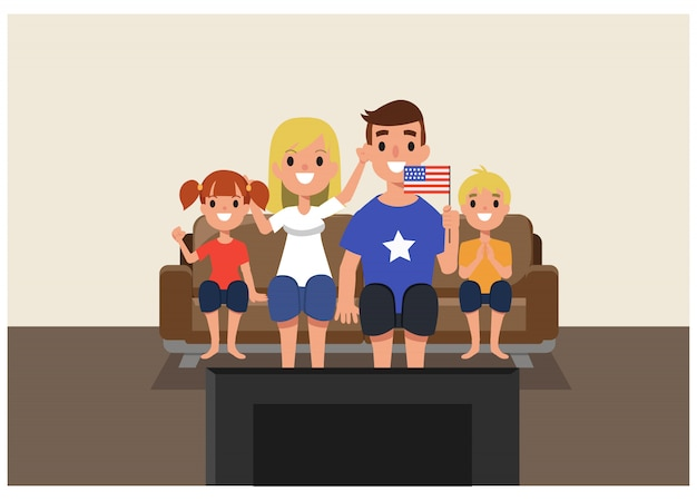 American family cheering in font of tv at home.