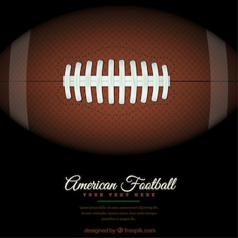 American football background with ball on the green field