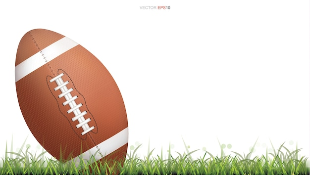 American football ball or rugby football ball on green grass court