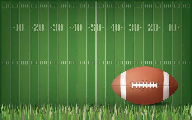 American football ball with green field background.