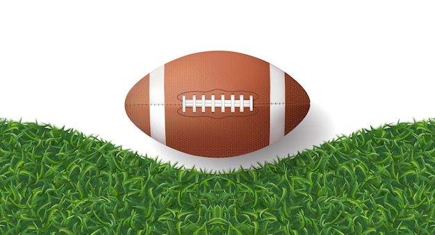 American football ball with green grass texture background.