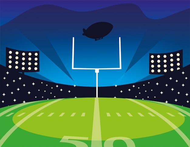 明るいライトとアメリカンフットボールフィールド