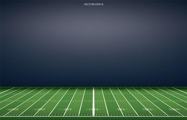 芝生のフィールドの遠近法線パターンとアメリカンフットボールスタジアムの背景