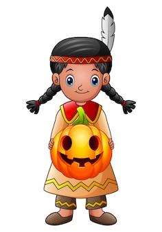 American indian girl holding pumpkin