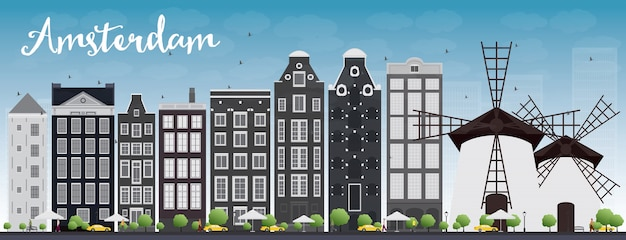 Amsterdam city skyline with grey buildings and blue sky