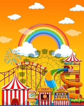 Amusement park scene at daytime with rainbow in the sky