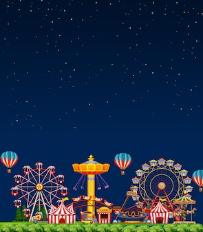 Amusement park scene at night with blank dark blue sky