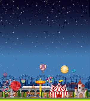 Amusement park scene at night with blank dark blue sky