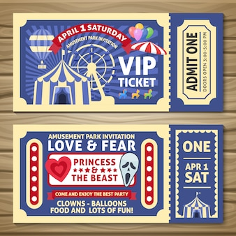 Amusement park tickets with red ribbons circus tent balloons on wooden table isolated