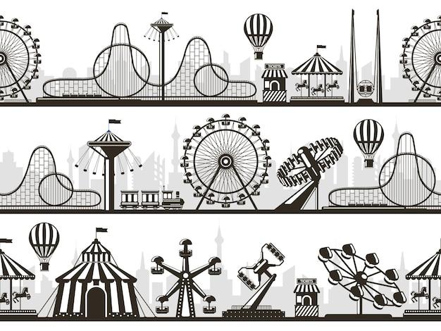 유원지 전망. 관람차와 롤러 코스터가있는 명소 공원 풍경 실루엣.