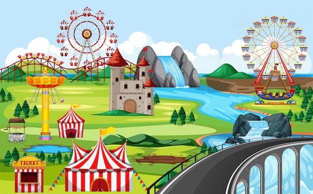 Парк развлечений с мостом и множеством аттракционов, тематический пейзаж