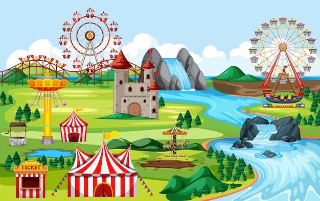 カーニバルと多くの乗り物の風景シーンがある遊園地