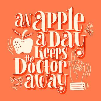 1日1個のリンゴが医者を遠ざける手描きのレタリングの引用