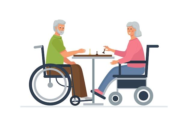 車椅子の老人と女性がチェスをします。障害者のための娯楽。