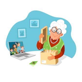 Пожилая женщина открывает посылку от своих детей. делайте подарки родителям, оставайтесь дома.
