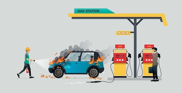 직원이 연료를 보급하는 동안 차를 태우는 화재를 진압하고 있습니다.