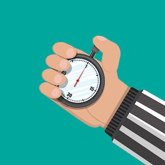Analog chronometer timer in hand of referee