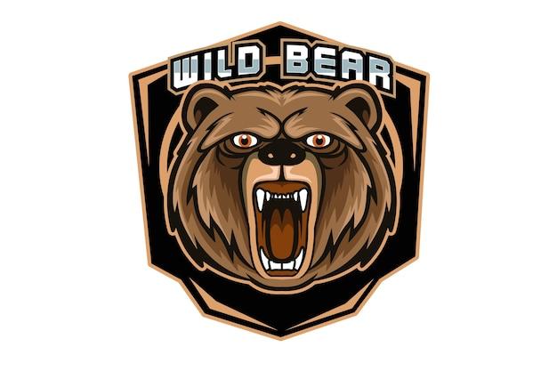 暗い背景で隔離のスポーツやeスポーツのロゴの怒っているクマのマスコット