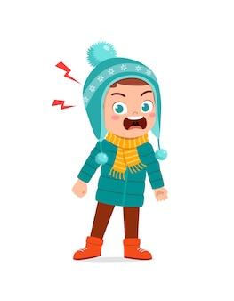 Angry cute little kid scream and wear jacket in winter season