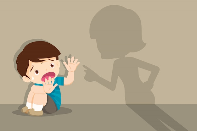 Angry mother scolds frightened child sitting on floor