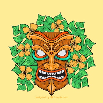 Angry tribal mask with flowers and palm leaves