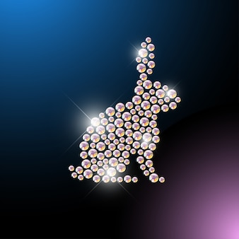 Animal portrait made with rhinestone gems isolated on black background. animal logo, animal icon. jewelry pattern, hand made product. shining pattern. animal silhouette, bunny sitting.