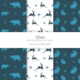 動物のシルエットの冬のパターンのコレクション