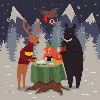 Animal tea party in the winter forest