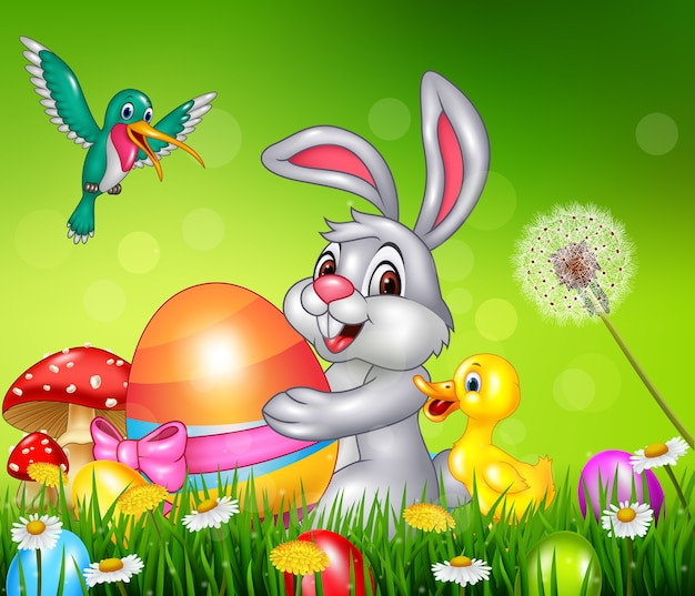 Animals and easter eggs on green grass