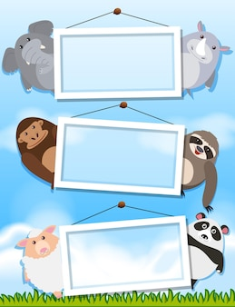 Animals holding empty frames in sky