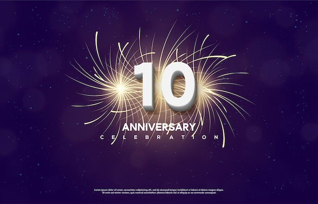 Anniversary celebration number with the number 10 is white with fireworks behind it.