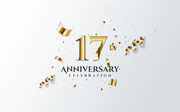 Anniversary celebration with the illustration of the 17th number in gold and scattered pieces of gold paper.