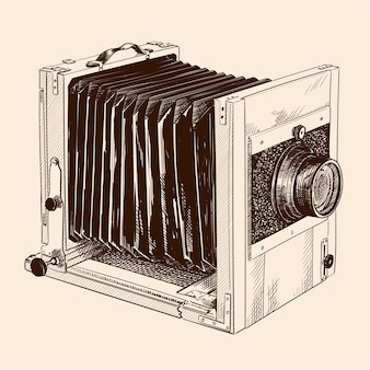 Antique formatted wooden camera with fur and lens isolated on beige background.