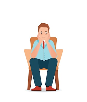 Anxious man feeling sadness and stress sitting on the chair