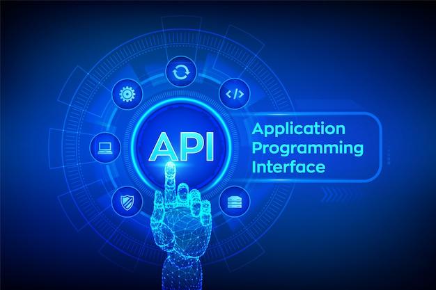 Api。アプリケーションプログラミングインターフェイス。デジタルインターフェイスに触れるロボットの手。