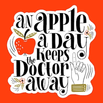 An apple a day keeps the doctor away handdrawn lettering quote for a healthy life