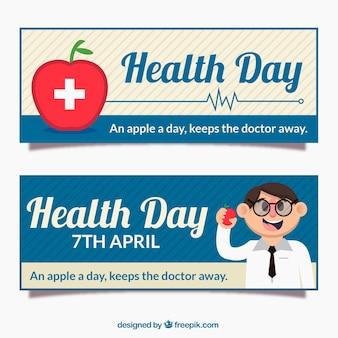 Striscioni apple e medico per la giornata della salute