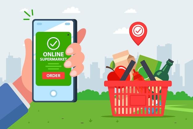 Заявка на доставку продукции. быстрый и удобный интернет-магазин продуктов. рука с мобильного телефона оплачивает заказ.
