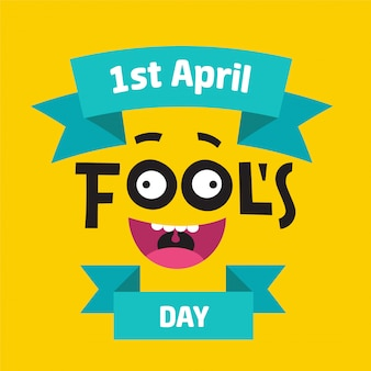 April fool's day concept with colorful text on yellow background