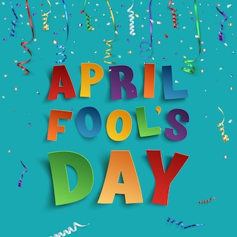 April fools day background with ribbons and confetti.