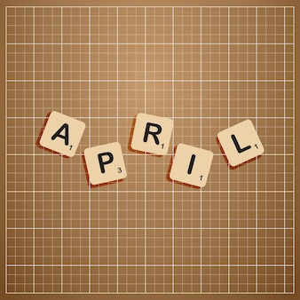Апрельский месяц заглавными буквами с концепцией блока scabbles